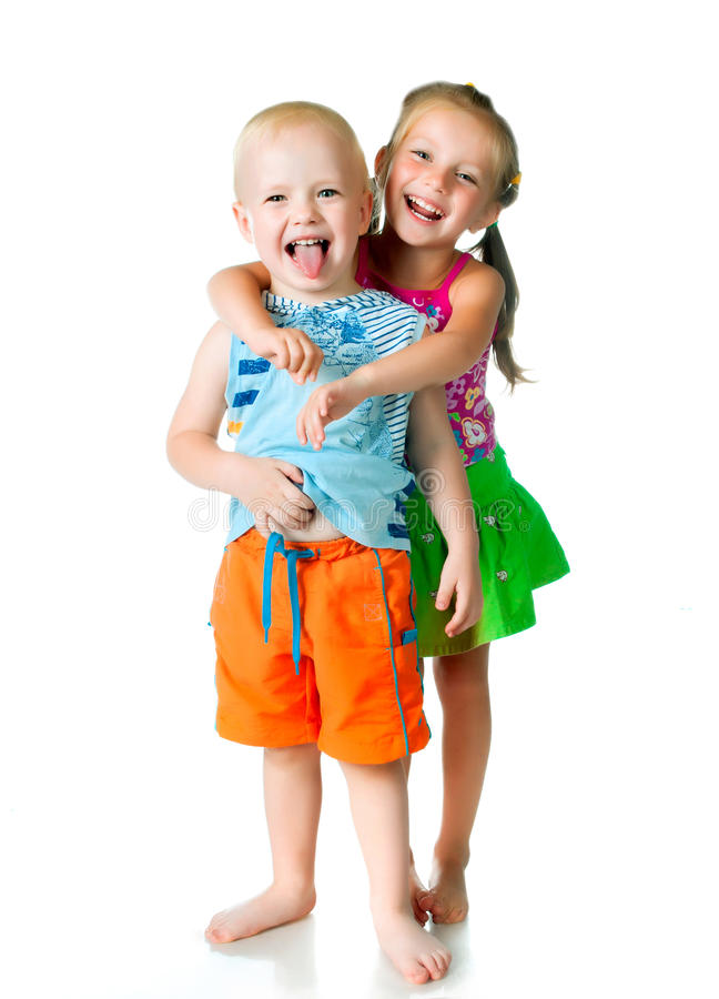Little brother and sister. On a white background royalty free stock photo