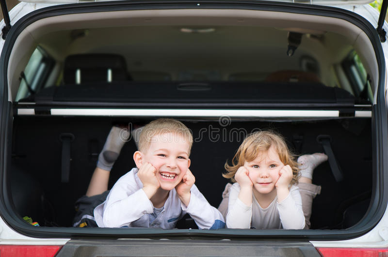 Boy brother sister in car