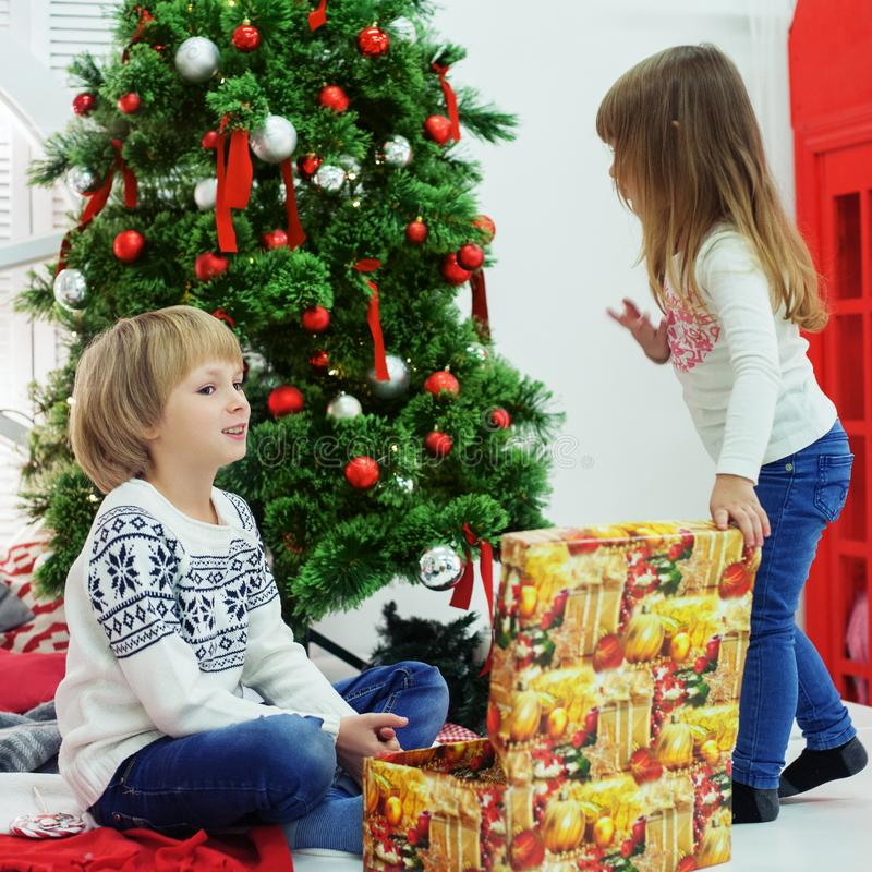 Little brother and sister received gifts. royalty free stock photo
