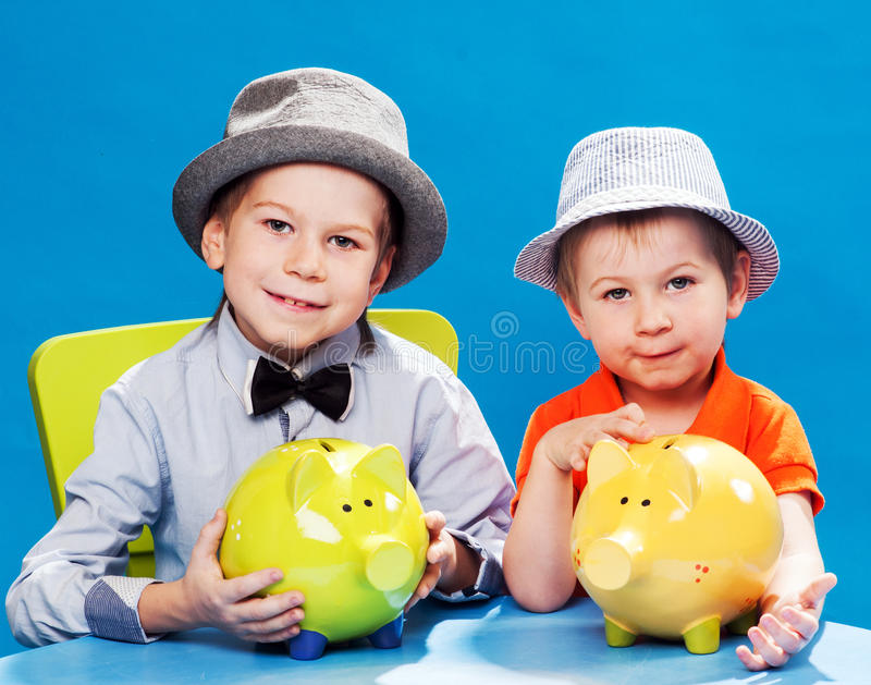 Little brothers businessmans. Counting money stock image