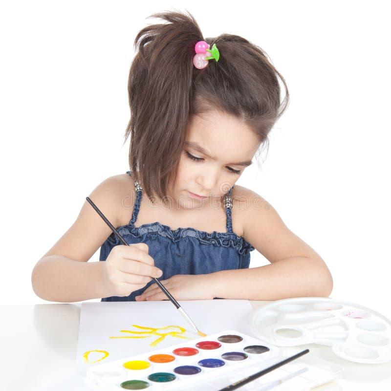 Download Little Brunette Girl Drawing At The Desk Stock Image - Image: 24554345