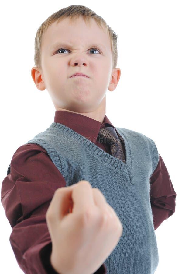 Little bully threatens fist stock photo