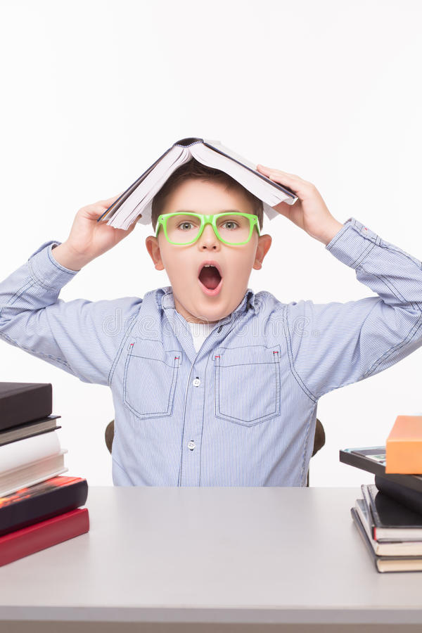 Little business boy hiding stock images