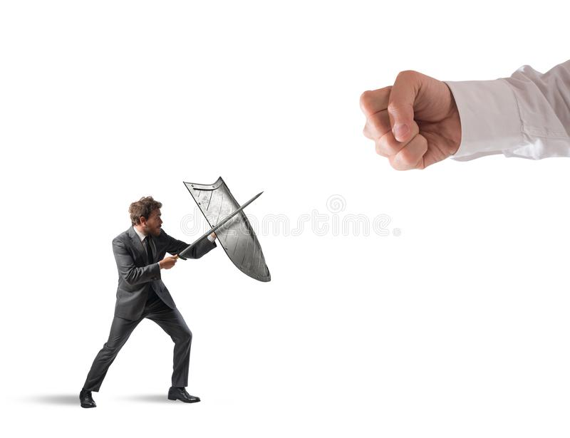 Little business man challenges big problems fighting with shield and sword stock images