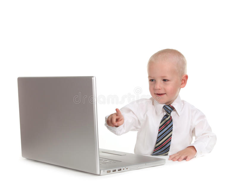 Little Business Prodigy Using a Laptop Computer royalty free stock image
