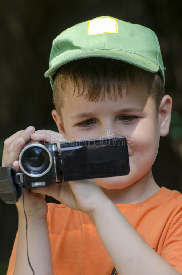 Download Little cameraman stock photo. Image of kids, video, boys - 32999348