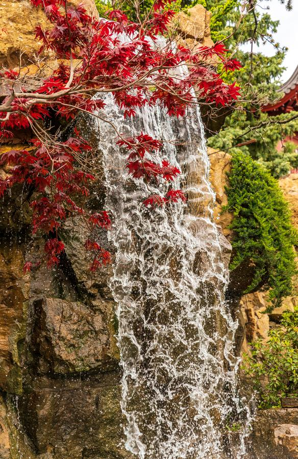 Little cascade in Chinese garden royalty free stock photography