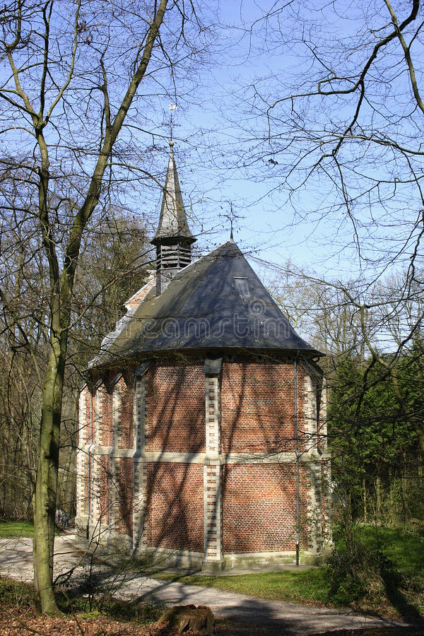 The little catholic chapel in a park, The Flanders, Belgium. A little catholic chapel in a park `Zoetwater`, The Flanders, Belgium stock photography