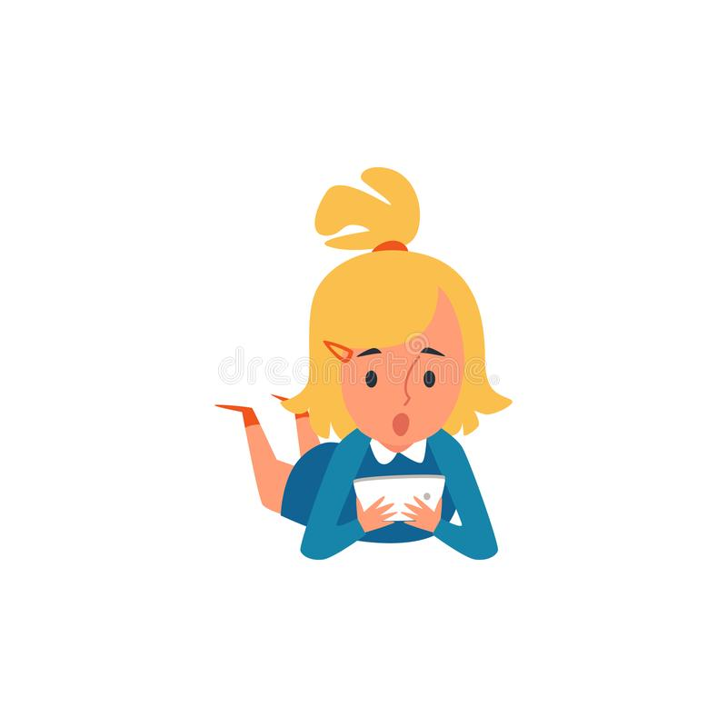 Little Caucasian blonde kid and child girl lying on the floor and playing at the tablet. royalty free illustration