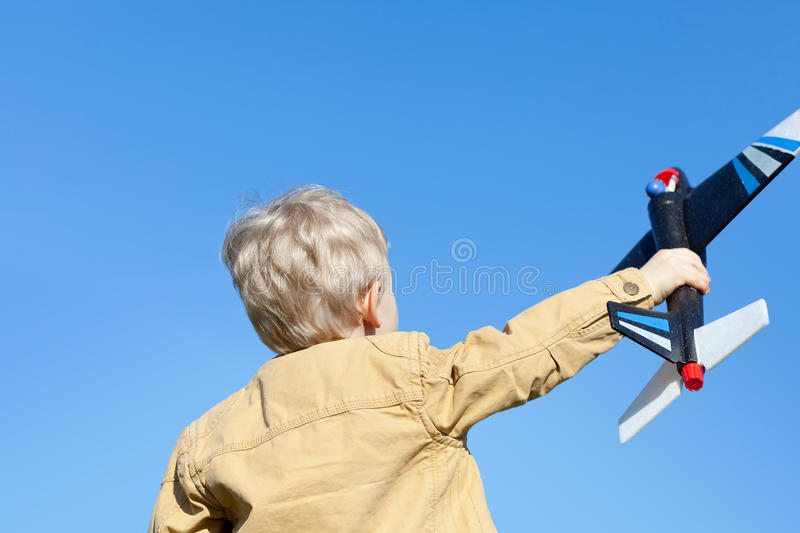 Boy Holding A Plane Royalty Free Stock Image