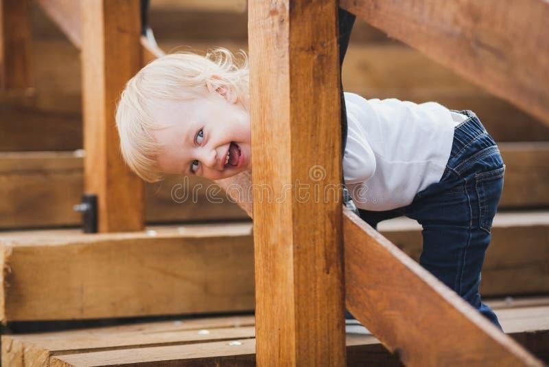 Little caucasian girl palaing hide and seek stock photos