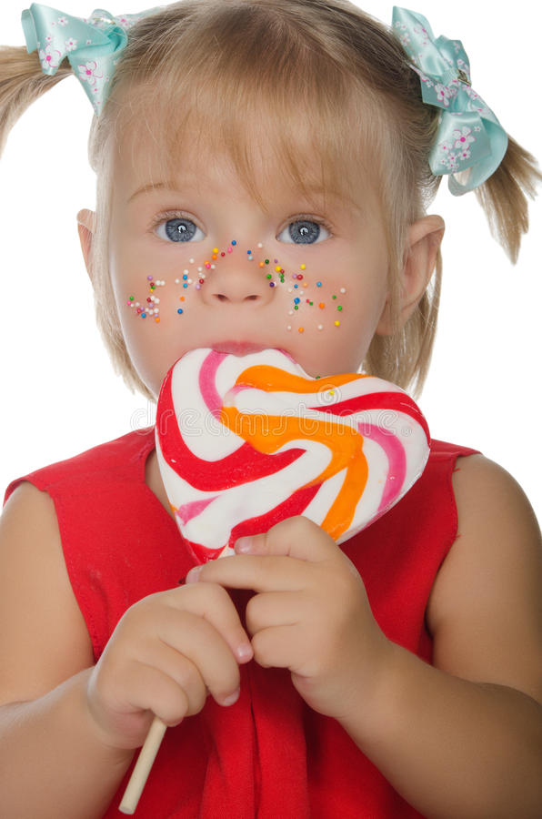 Little charming girl with colored Lollipop. Isolated in white stock photos
