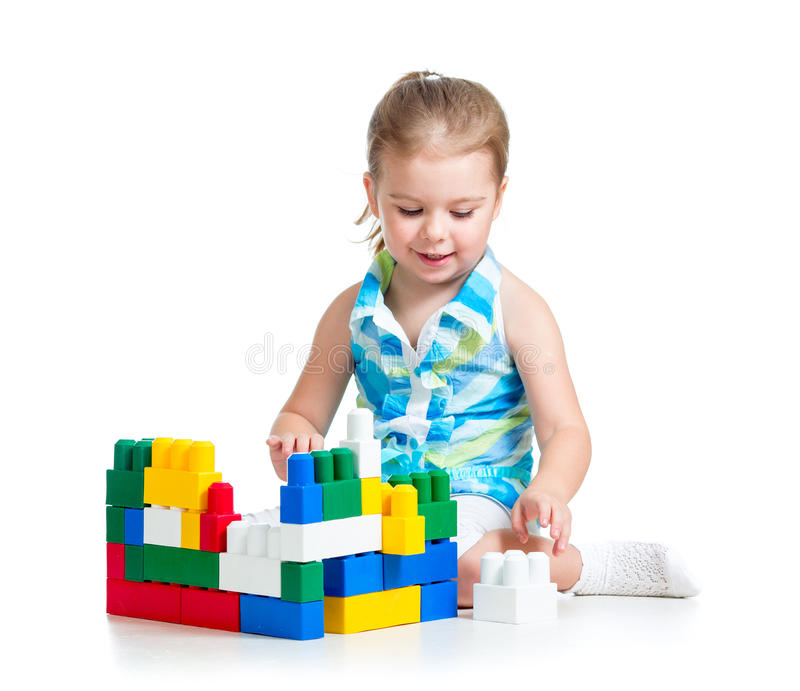 Download Little Cheerful Child With Construction Set Over White Backgroun Stock Photo - Image: 28401046