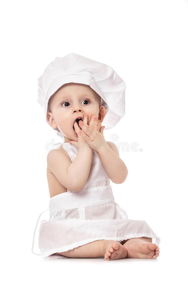 Little Chef. Adorable baby boy dressed in s chef`s hat. isolated on white. big size resolution. Food banner for text or design royalty free stock photography