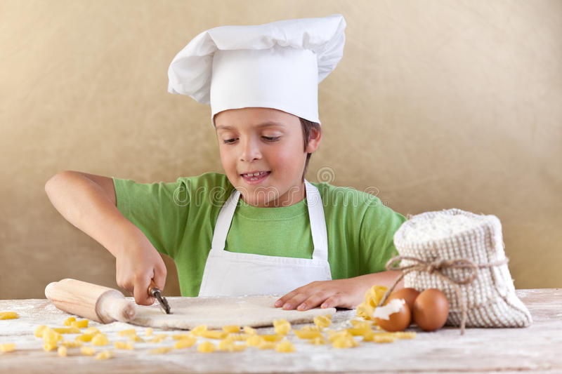 Little Chef Cutting The Dough Making Pasta Royalty Free Stock Photo