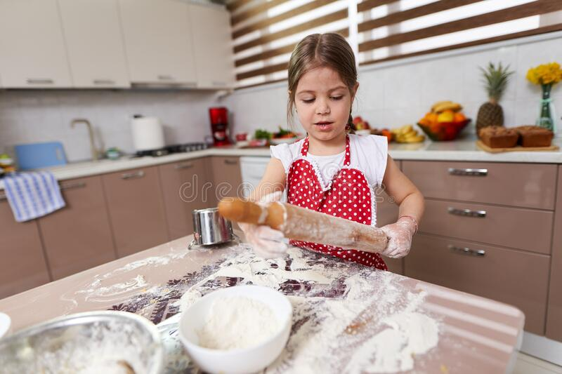 Young girl kneading dough stock image