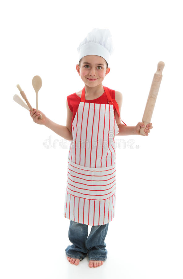 Little chef holding kitchen utensils stock photos