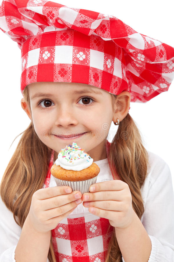 Download Little chef holding muffin stock photo. Image of plate - 24041706