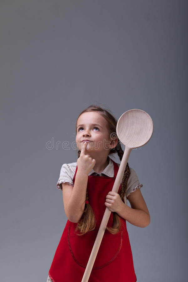 Little chef thinking about what to cook royalty free stock photo