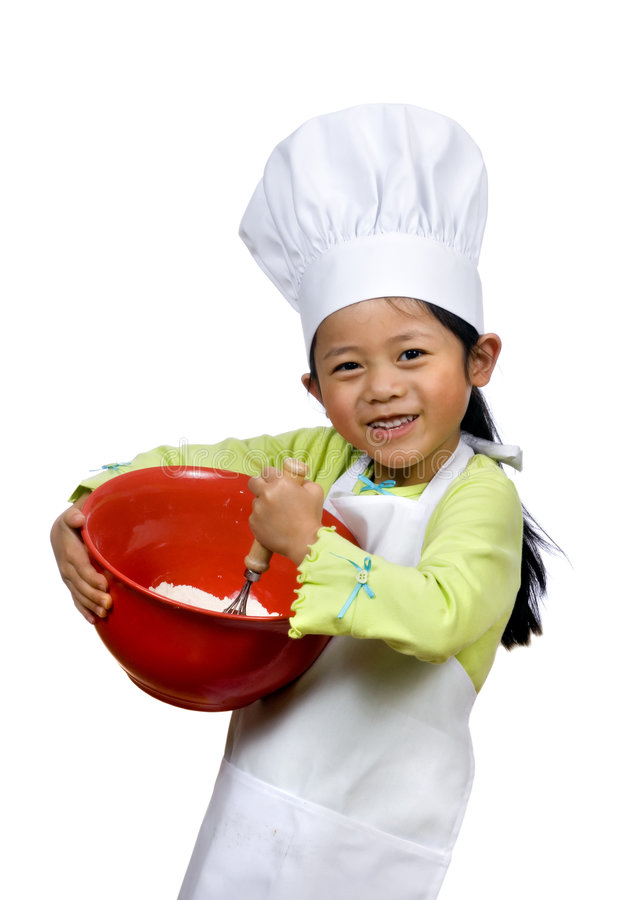 Little Chefs 005. A young girl having fun in the kitchen making a mess....I mean making cookies. Education, learning, cooking, childhood stock photo