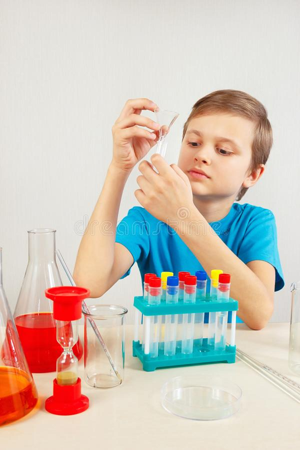Little chemist doing chemical experiments in laboratory. Little chemist doing chemical experiments in the laboratory royalty free stock photography