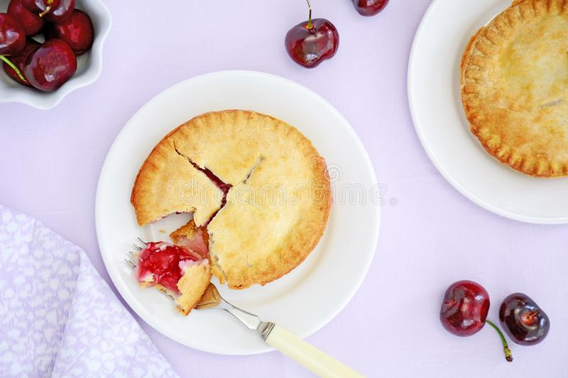 Little cherry pies on mauve stock images