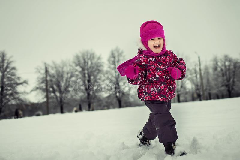 Little chil playing in winter forest royalty free stock photos
