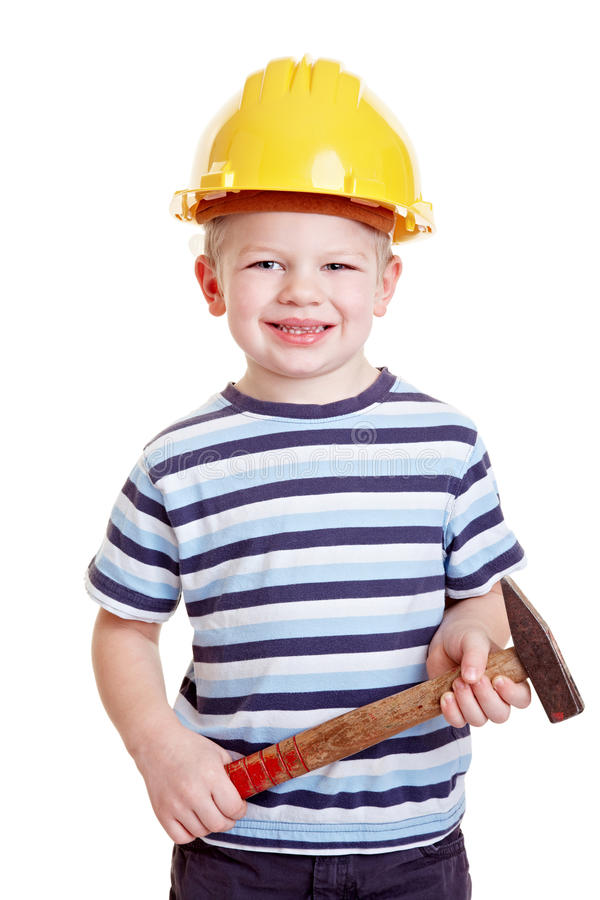 Little child as construction worker. Happy boy child as a construction worker with hammer and helmet stock images