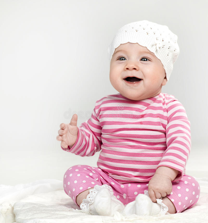 Little child baby. Sitting smiling in funny cloth royalty free stock image