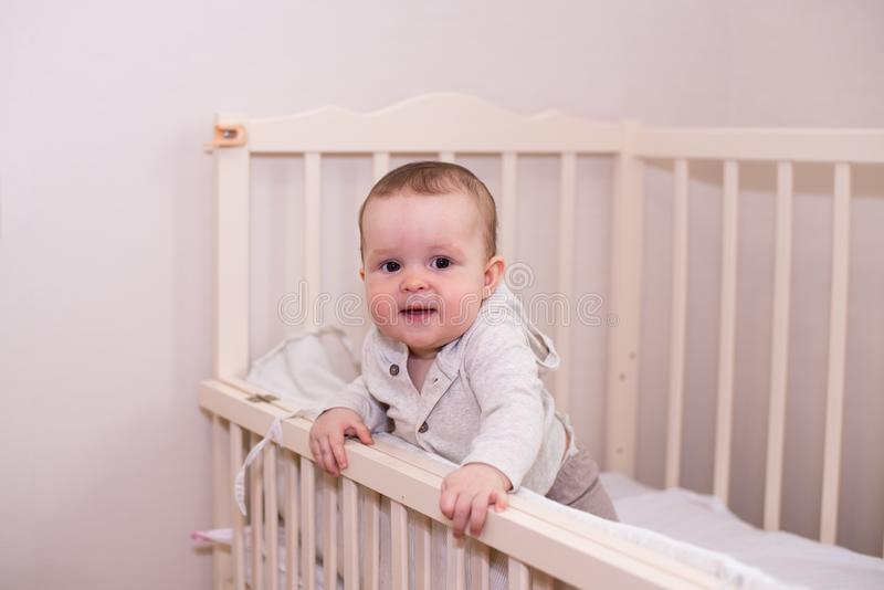 Little child baby smiling in bed . copy space stock photography