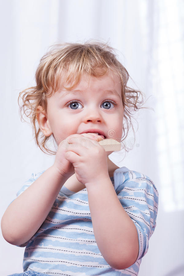 Little child biting toy stock images
