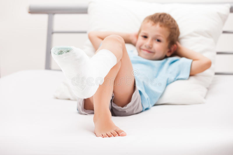 Little child boy with plaster bandage on leg heel fracture or br. Human healthcare and medicine concept - little child boy with plaster bandage on leg heel stock photos
