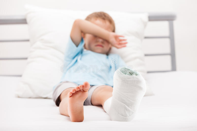 Little child boy with plaster bandage on leg heel. Human healthcare and medicine concept - little child boy with plaster bandage on leg heel fracture or broken stock photos