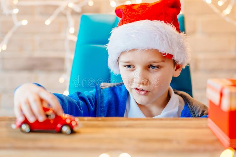 Little child boy playing with red toy car. Little child boy playing with small red toy car - a Christmas present stock photography