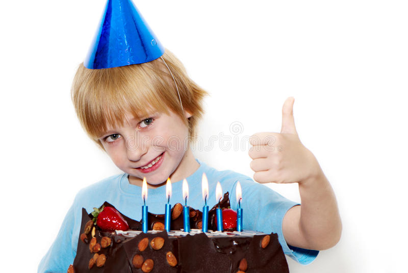 Little Child With Cap And Cake Royalty Free Stock Photos