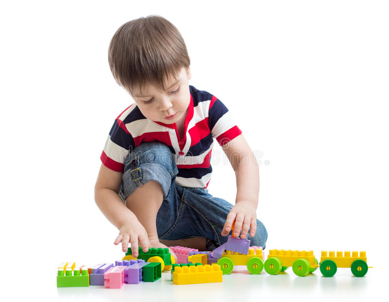 Little child with construction set over white stock image