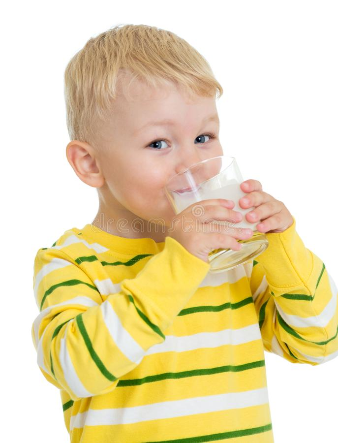 Little child drinking milk or kefir isolated stock photography