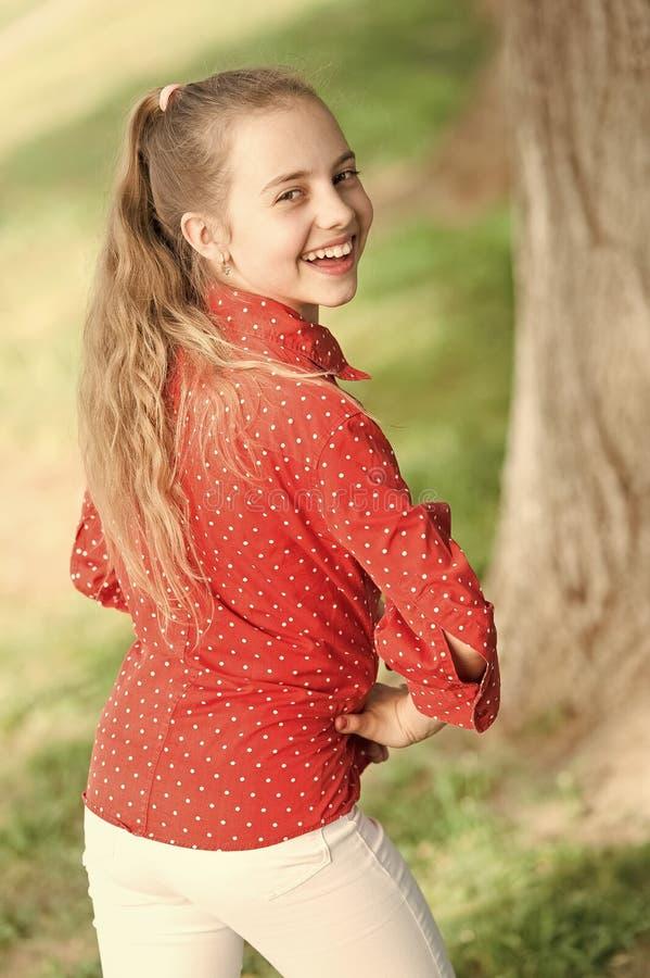 Little child enjoy walk park. Weekend time. Girl carefree child. Summer holidays. Emotional kid nature background. Child stock image