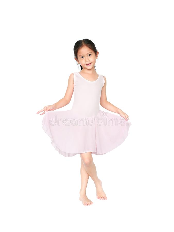 Little child girl dreams of becoming a ballerina. Beautiful little Asian children in pink tutu skirt isolated on white background royalty free stock images