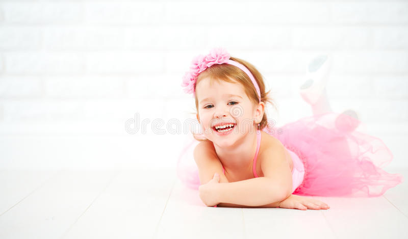 Little child girl dreams of becoming ballerina. In a pink tutu skirt royalty free stock images