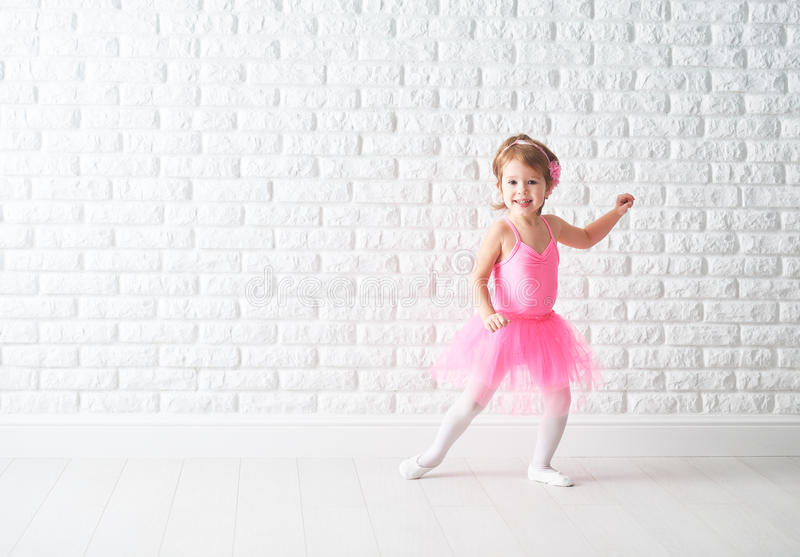 Little child girl dreams of becoming ballerina. In a pink tutu skirt stock photo