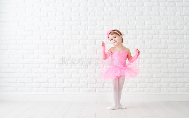 Little child girl dreams of becoming ballerina. In a pink tutu skirt stock photos