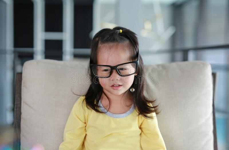 Little child girl with Glasses in library, Education concept.  stock photos