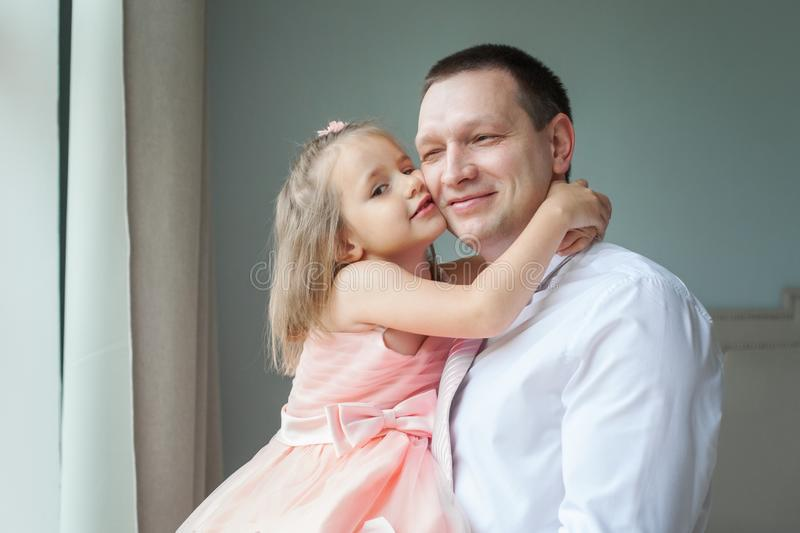 Little child girl kissing her daddy, portrait royalty free stock images