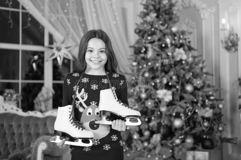 Little child girl likes xmas present. Christmas. Kid enjoy the holiday. Happy new year. small happy girl at christmas. The morning before Xmas. New year royalty free stock photos