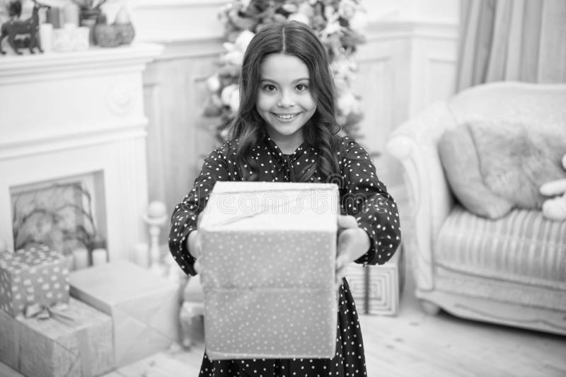 Little child girl likes xmas present. Christmas. Kid enjoy the holiday. Happy new year. small happy girl at christmas. The morning before Xmas. New year stock image