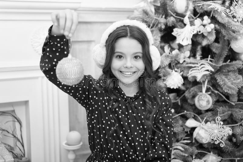 Little child girl likes xmas present. Christmas. Kid enjoy the holiday. Happy new year. small happy girl at christmas. The morning before Xmas. warm earphones stock photo