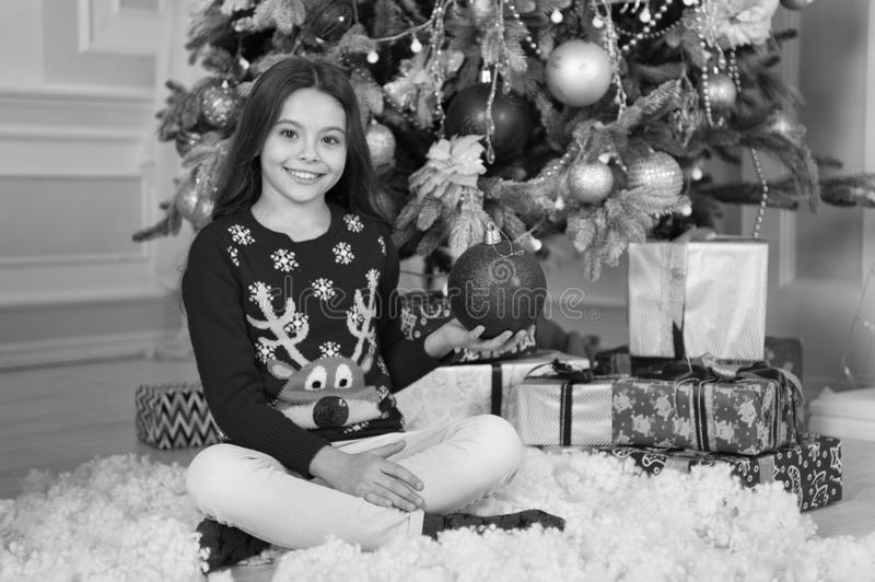 Little child girl likes xmas present. Christmas. Kid enjoy the holiday. Happy new year. small happy girl at christmas stock photography