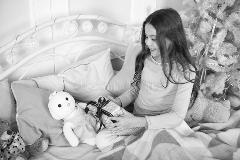 Little child girl likes xmas present. Christmas. Kid enjoy holiday. Happy new year. small happy girl at christmas. The. Morning before Xmas. New year holiday royalty free stock photos