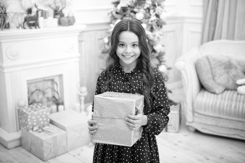 Little child girl likes xmas present. Christmas. Kid enjoy the holiday. Happy new year. small happy girl at christmas. The morning before Xmas. New year stock photo